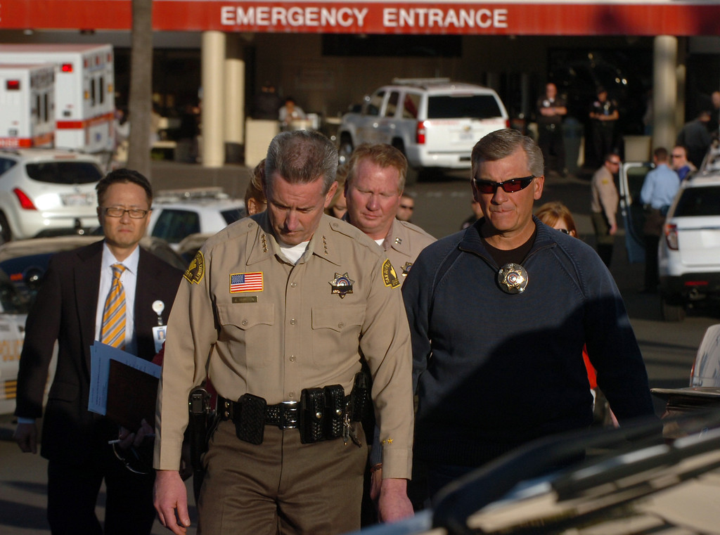 Description of . San Bernardino County Sheriff John McMahon dropes his head as he walks out of the ER at Loma Linda University Medical Center to report to the media that one police officer was killed and one injured by Christopher Dorner in the Big Bear area in Loma Linda February 12, 2013.  ON13-Dorner-01-TRC (Thomas R. Cordova/Staff Photographer)