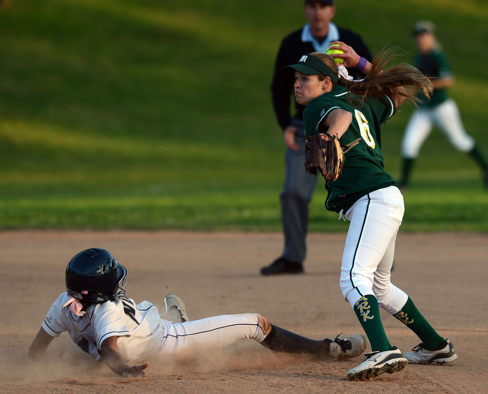 . North\'s Lexi Hendon (12) is forced out at second as Moorpark\'s Madison Fleming attempts a double play in a pool play softball game of the TNT Tournament at Wilson Park in Torrance. 20130321 Photo by Steve McCrank / Staff Photographer