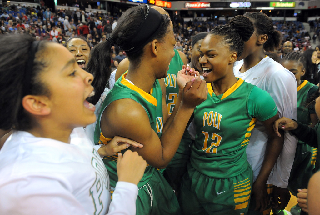 . Long Beach Poly players celebrate their championship at Sleep Train Arena in Sacramento, CA on Saturday, March 29, 2014. Long Beach Poly vs Salesian in the CIF Open Div girls basketball state final. 2nd half. Poly won 70-52. (Photo by Scott Varley, Daily Breeze)