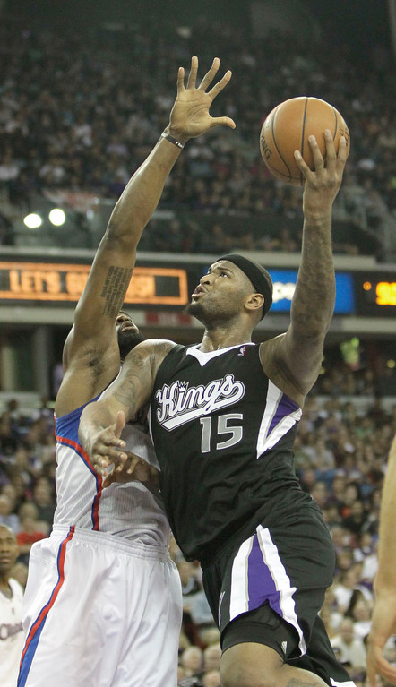 . Sacramento Kings  center DeMarcus Cousins, right, drives to the basket against Lost Angeles Clippers center DeAndre Jordan during the third quarter of an NBA basketball game in Sacramento, Calif., Wednesday,  April 17, 2013.  The Clippers own 112-108.(AP Photo/Rich Pedroncelli)