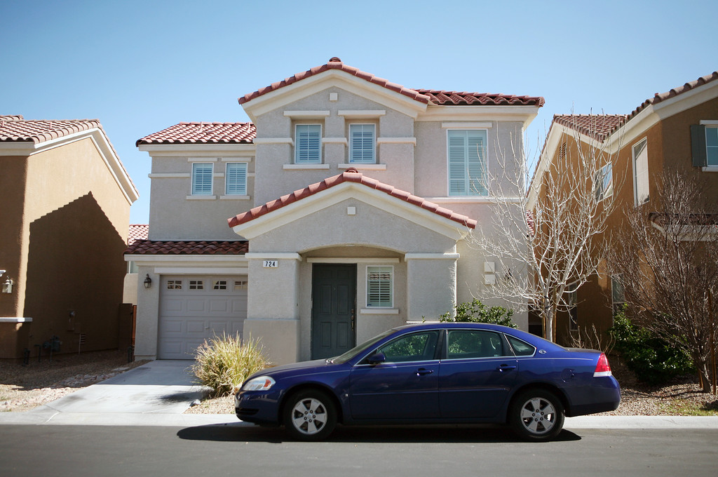 Description of . Christopher Jordan Dorner's Las Vegas home, located at 724 Loughton St., is shown Thursday, Feb. 7, 2013, in Las Vegas. Police have launched a massive manhunt for the former Los Angeles officer suspected of killing a couple over the weekend and opening fire on four officers early Thursday, Feb. 7, 2013, killing one and critically wounding another, authorities said. Mandatory Credit (Ronda Churchill/Las Vegas Review-Journal)