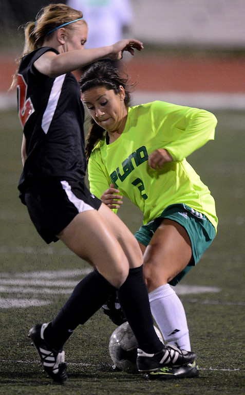 Description of . BS15-UPLANDSOCCER-02-JCM (Jennifer Cappuccio Maher/Staff Photographer) San Clemente's Sami Engel, left, guards Upland's Isabella Solorzano as she tries to advance the ball during the CIF-SS Division 1 playoff game Thursday, February 14, 2013, at Upland High School in Upland. Upland was eliminated by San Clemente 1-0 in overtime.