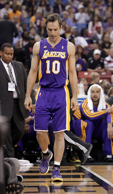 . Los Angeles Lakers guard Steve Nash walks to the locker room after injuring his hamstring during the first quarter of an NBA basketball game against the Sacramento Kings in Sacramento, Calif., Saturday, March 30, 2013. (AP Photo/Rich Pedroncelli)