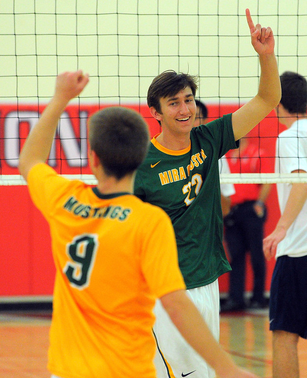 . REDONDO BEACH - 04/25/13 - (Photo: Scott Varley, Los Angeles Newspaper Group)  Mira Costa boys volleyball swept Redondo 3-0 in a Bay League matchup at Redondo. Costa\'s Connor Inlow, right, celebrates match point with Dillon Shambaugh.