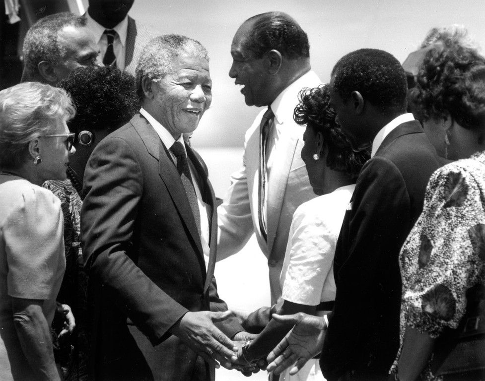 . June 1990: Nelson Mandela is greeted by Los Angeles Mayor Tom Bradley and other dignitaries as he arrives at LAX.  Daily News file photo