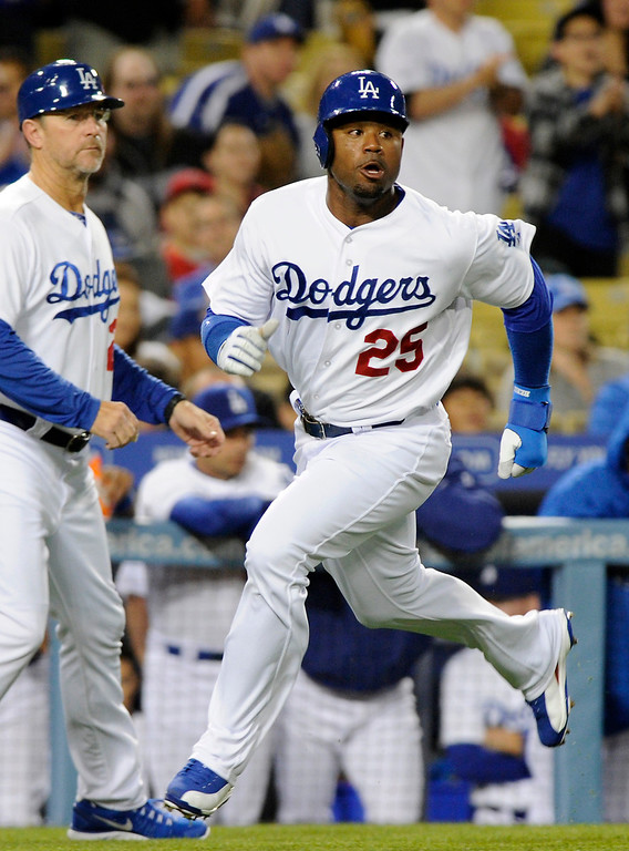 . The Dodgers\' Carl Crawford scores on a double by Matt Kemp in the first inning against the Angels, Friday, March 29, 2013, at Dodger Stadium. (Michael Owen Baker/Staff Photographer)