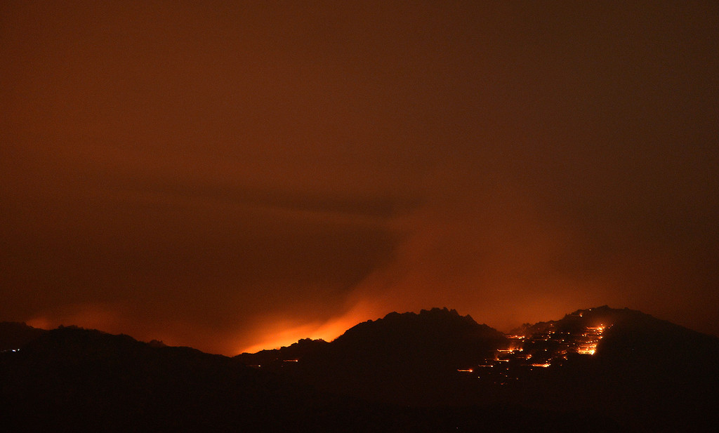 . Fire lights up the night skies from the Mountain Fire near Idyllwild, California July 18, 2013. The blaze erupted on Monday afternoon about 100 miles (161 km) east of Los Angeles in the scenic but rugged San Jacinto Mountains that overlook Palm Springs, Rancho Mirage and several smaller desert towns. Photo by Gene Blevins/LA Dailynews