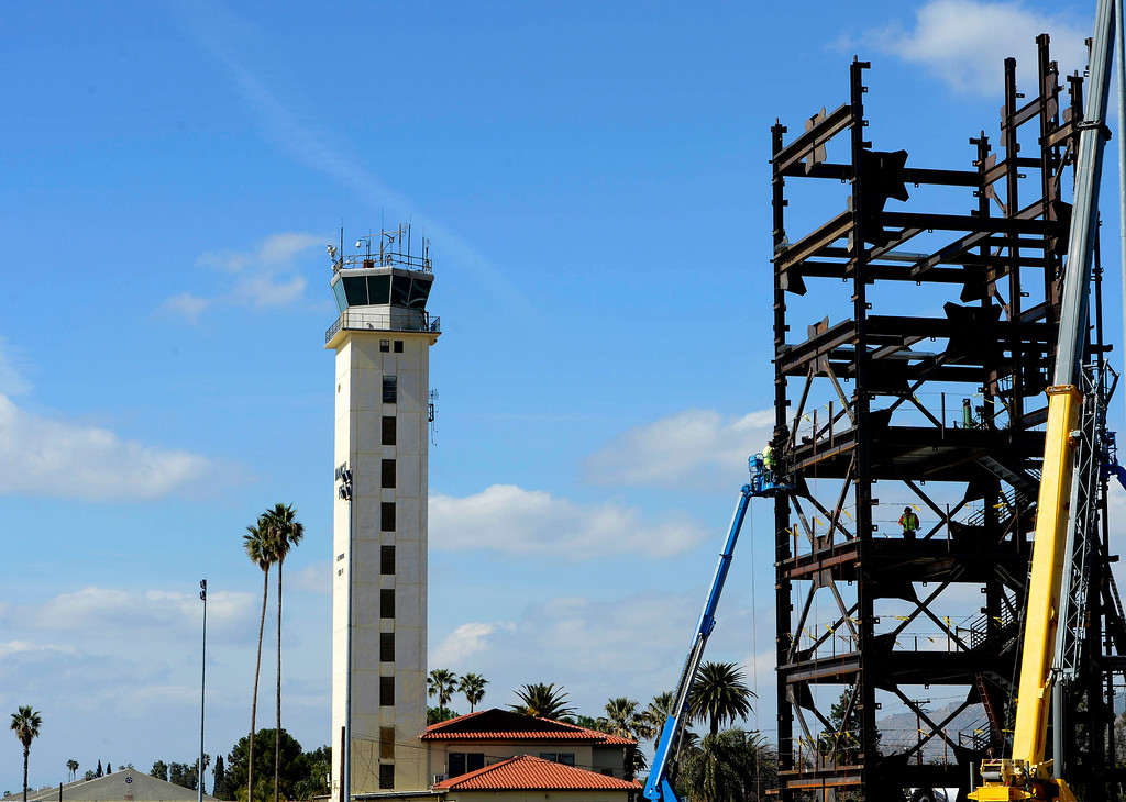 Description of . The current Control Tower/ Base Ops stands at left, as the new control tower is under construction at March Air Reserve Base in Riverside March  6, 2013.   The tower is slated to be completed by January 2015. GABRIEL LUIS ACOSTA/STAFF PHOTOGRAPHER.