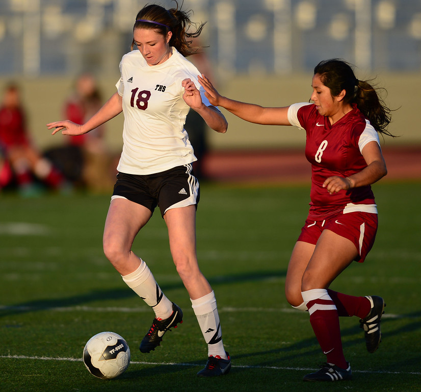 . Downey\'s Kelsey Aparicio (8) and Torrance\'s Haley Noble (18) battle for the ball in a CIF SS Division IV quarterfinal game Thursday at Zamperini Field. Downey won the game 3-1. 20130221 Photo by Steve McCrank / Staff Photographer