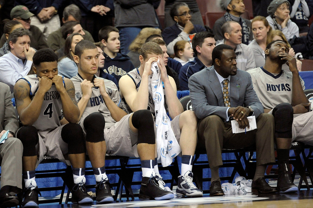 . Georgetown players and personnel react on the bench in the final minutes of a second-round game against Florida Gulf Coast in the NCAA college basketball tournament on Friday, March 22, 2013, in Philadelphia. Florida Gulf Coast won 78-68. (AP Photo/Michael Perez)