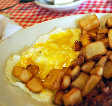 Perfectly over-easy eggs and home fries!