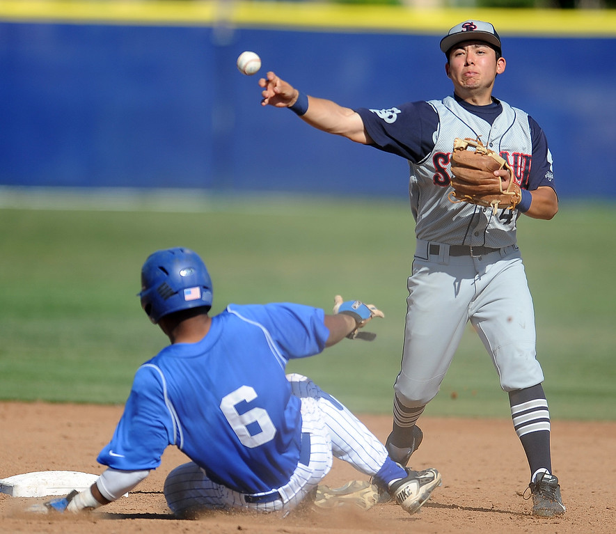 Description of . St. Paul's Gabriel Esquer (4) forces out Bishop Amat's Daryl Daniels (6) in the third inning of a prep baseball game at Bishop Amat High School on Friday, April 19, 2012 in La Puente, Calif. Bishop Amat won 3-2.    (Keith Birmingham/Pasadena Star-News)