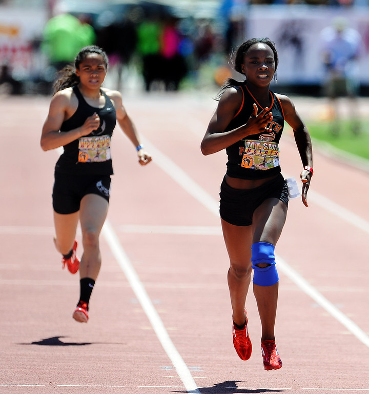 Description of . Laura Anuakpado, right, of South Pasadena finished second in the 400 meter dash invitational high school during the Mt. SAC Relays in Hilmer Lodge Stadium on the campus of Mt. San Antonio College on Saturday, April 20, 2012 in Walnut, Calif.    (Keith Birmingham/Pasadena Star-News)