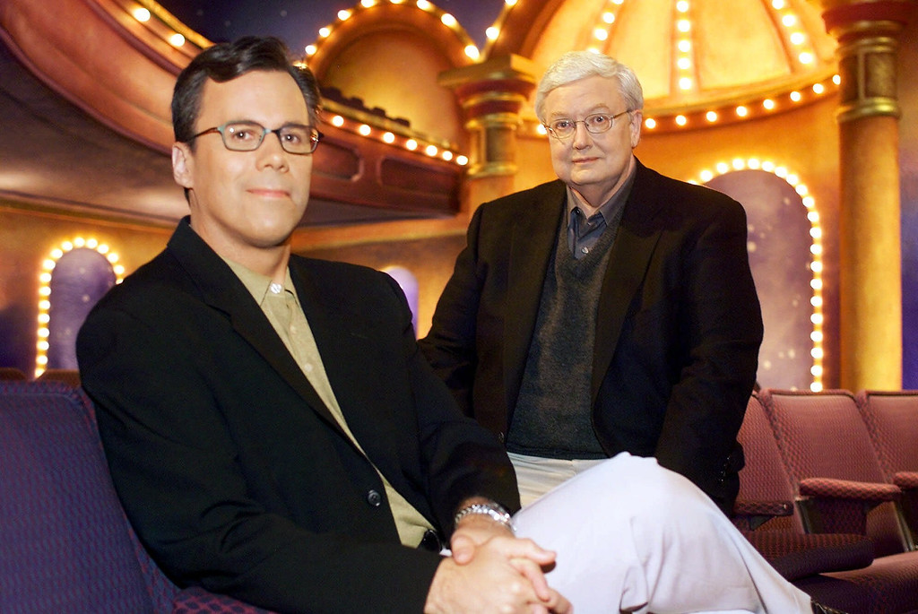 ". Chicago Sun-Times columnist Richard Roeper, left, sits with Sun-Times film critic Roger Ebert on the set of the newly named ""Ebert & Roeper and The Movies\"" Wednesday, July 12, 2000, in Chicago. It was announced Wednesday that Roeper would permanently replace Gene Siskel, who died last year, in the chair opposite Ebert on the long-running film criticism television show. (AP Photo/Fred Jewell)"
