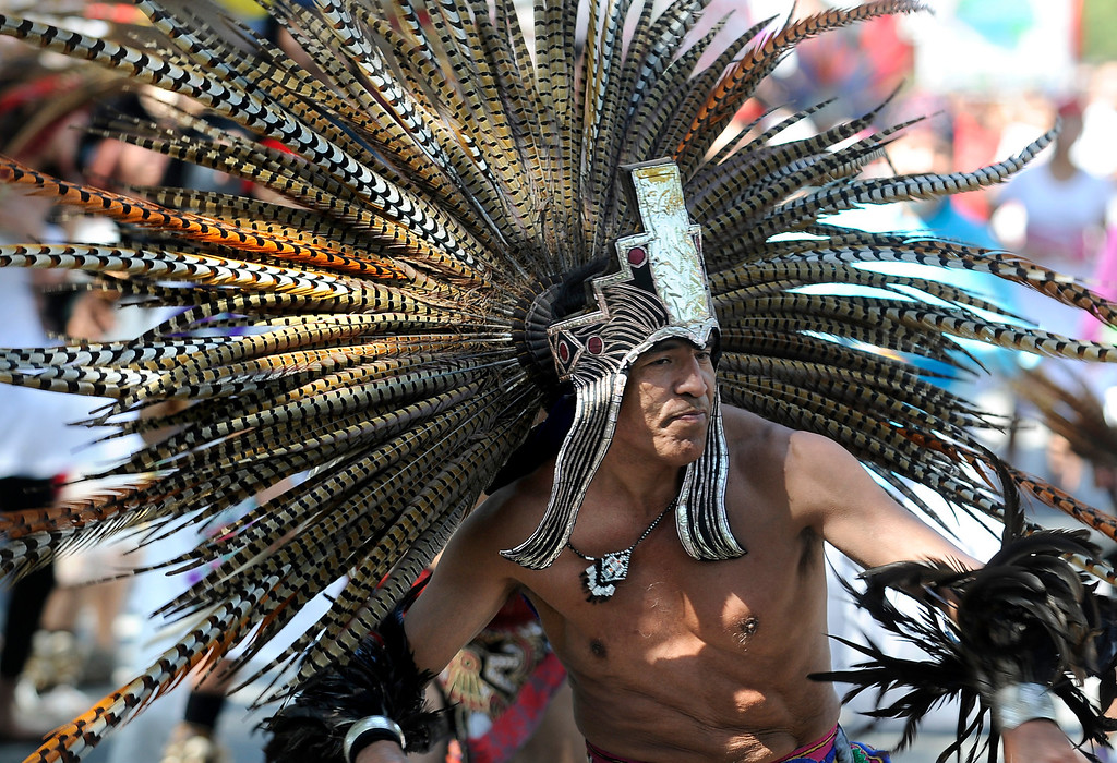 . An Aztec dancer dances during the march. Approximately 4,000 Angelinos marched 2 miles from Brand Park to Ritchie Valens Park during the Annual Cesar Chavez March for Justice. Mission Hills, CA 3/23/2013(John McCoy/Staff Photographer