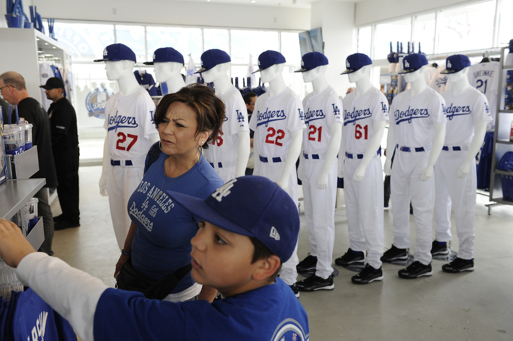 . Laura Finn of Simi Valley and her son Jonathan Finn look at merchandise in the Dodgers store at the home opener. The Los Angeles Dodgers played the San Francisco Giants in the opening game of the new season. Los Angeles, CA 4/01/2013. Michael Owen Baker/staff photographer