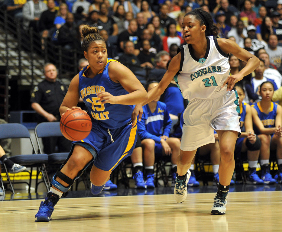 Description of . Bishop Amat's Leeah Powell (#15) tries to fend off Canyon Springs' Chariaha Scott (#21) in the CIF-SS Division 1A girls basketball finals at the Anaheim Arena on Friday March1, 2013. Canyon Springs beat Bishop Amat 48-46. (SGVN/Staff Photo by Keith Durflinger)