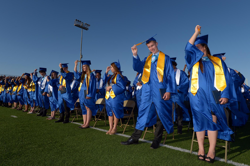 . Tessa Tomanelli, right, and Reid Thom move their tassles from right to left. The 2013 North High School commencement ceremonies take place on the school\'s football field in Torrance Wednesday afternoon.