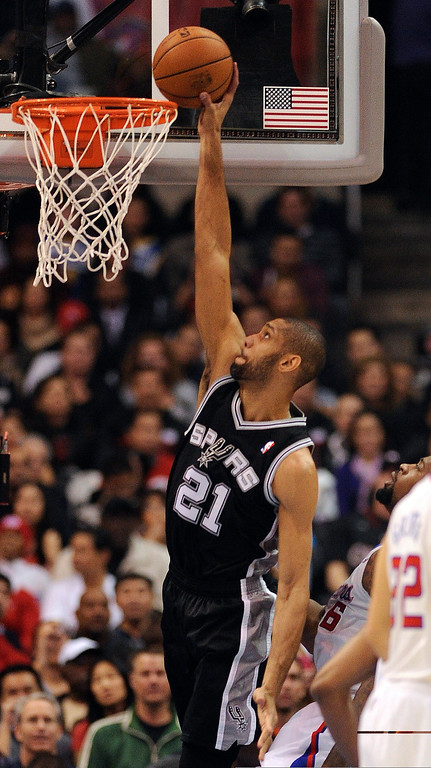 . The Spurs\' Tim Duncan #21 dunks the ball as the Clippers\' DeAndre Jordan #6 defends during their game at the Staples Center in Los Angeles Friday, February  21, 2013. (Hans Gutknecht/Staff Photographer)