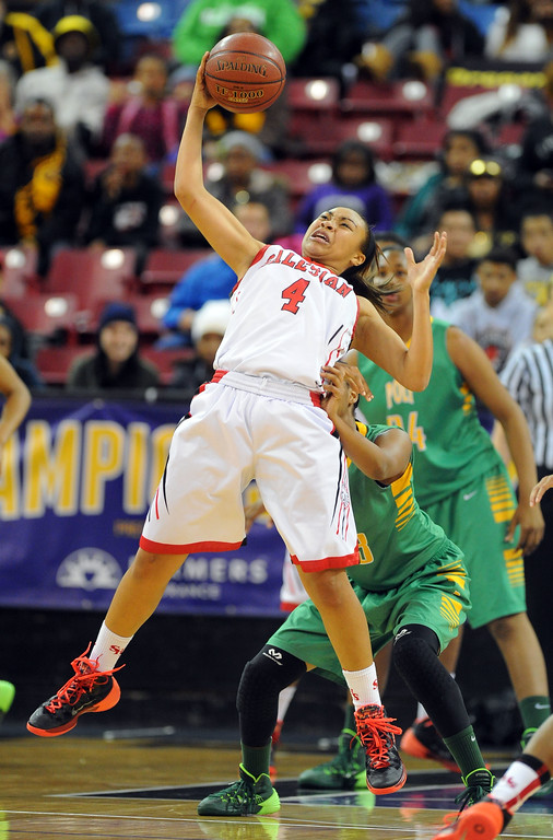 . Salesian\'s Mariya Moore grabs the ball at Sleep Train Arena in Sacramento, CA on Saturday, March 29, 2014. Long Beach Poly vs Salesian in the CIF Open Div girls basketball state final. 2nd half. Poly won 70-52. (Photo by Scott Varley, Daily Breeze)