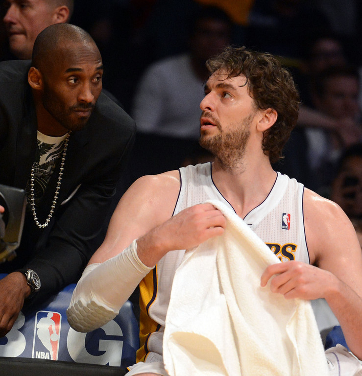. An injured Kobe Bryant talks with Pau Gasol on the bench during game four of their NBA Western Conference playoffs at the Staples Center Saturday, April 28, 2013. The Spurs beat the Lakers 120-89. The Spurs beat the Lakers 103-82. (Hans Gutknecht/Staff Photographer)