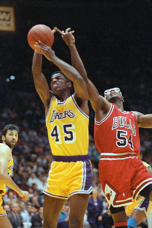 . Los Angeles Lakers\' A.C. Green (45) out reaches Chicago Bulls\' Horace Grant (54) for the rebound in first quarter action in game five of the NBA finals at the Forum in Inglewood, Calif., Wednesday, June 12, 1991. (AP Photo/Eric Risberg)
