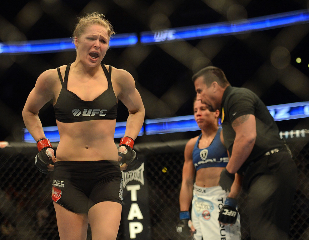 . UFC women�s bantamweight champion Ronda Rousey celebrates her victory over challenger Liz Carmouche during their UFC 157 match at the Honda Center in Anaheim, CA Saturday, February 23, 2013. Rousey beat Carmouche via first round submission. (Hans Gutknecht/Staff Photographer)