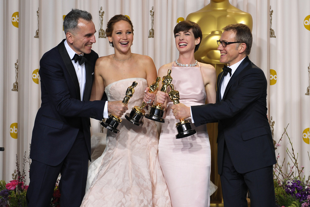 ". From left, Daniel Day-Lewis, with his award for best actor in a leading role for ""Lincoln,\"" Jennifer Lawrence, with her award for best actress in a leading role for \""Silver Linings Playbook,\"" Anne Hathaway, with her award for best actress in a supporting role for \""Les Miserables,\"" and actor Christoph Waltz, with his award for best actor in a supporting role for \""Django Unchained,\"" pose during the Oscars at the Dolby Theatre on Sunday Feb. 24, 2013, in Los Angeles. (Photo by John Shearer/Invision/AP)"