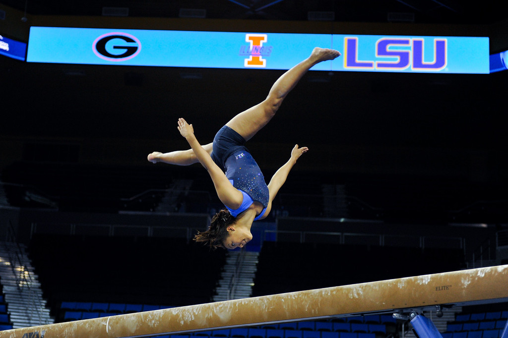 . UCLA\'s Lichelle Wong practices on the beam. (Michael Owen Baker/Staff Photographer)