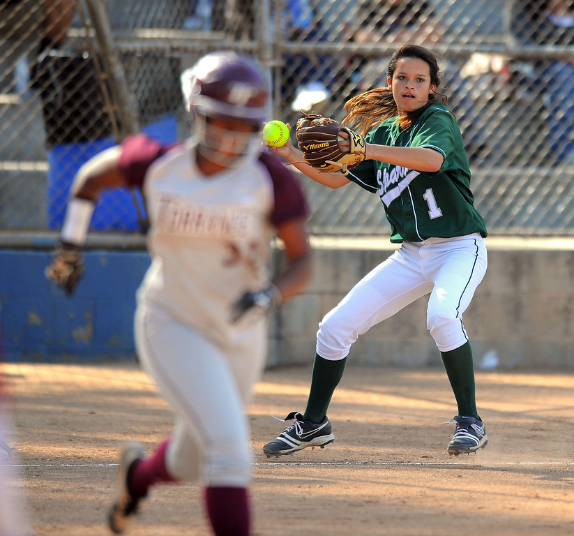 . TORRANCE - 04/03/2013  (Photo: Scott Varley, Los Angeles Newspaper Group)  South vs Torrance softball in a Pioneer League matchup. Torrance hitter Christina Washington beats the throw to first base by South\'s Kelsie Bozart.