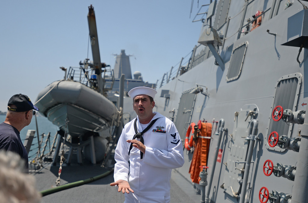 . People take a tour of the USS Spruance, an Arleigh Burke-class guided missile destroyer, which is docked in the Port of Los Angeles for Navy Days.  FC3 Robert Kivett (SW) discusses the ship. Saturday, August 09, 2014, San Pedro, CA.   Photo by Steve McCrank/Daily Breeze