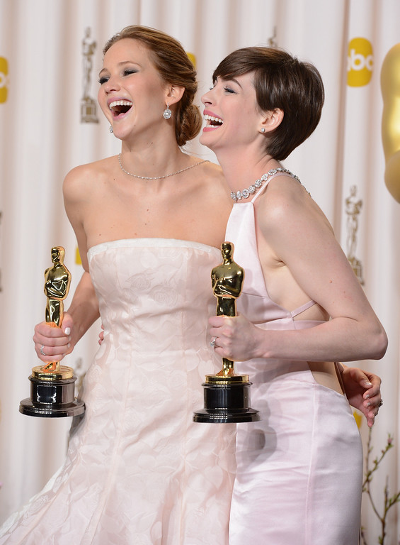 . Oscar winners Jennifer Lawrence and Anne Hathaway backstage at the 85th Academy Awards at the Dolby Theatre in Los Angeles, California on Sunday Feb. 24, 2013 ( David Crane, staff photographer)