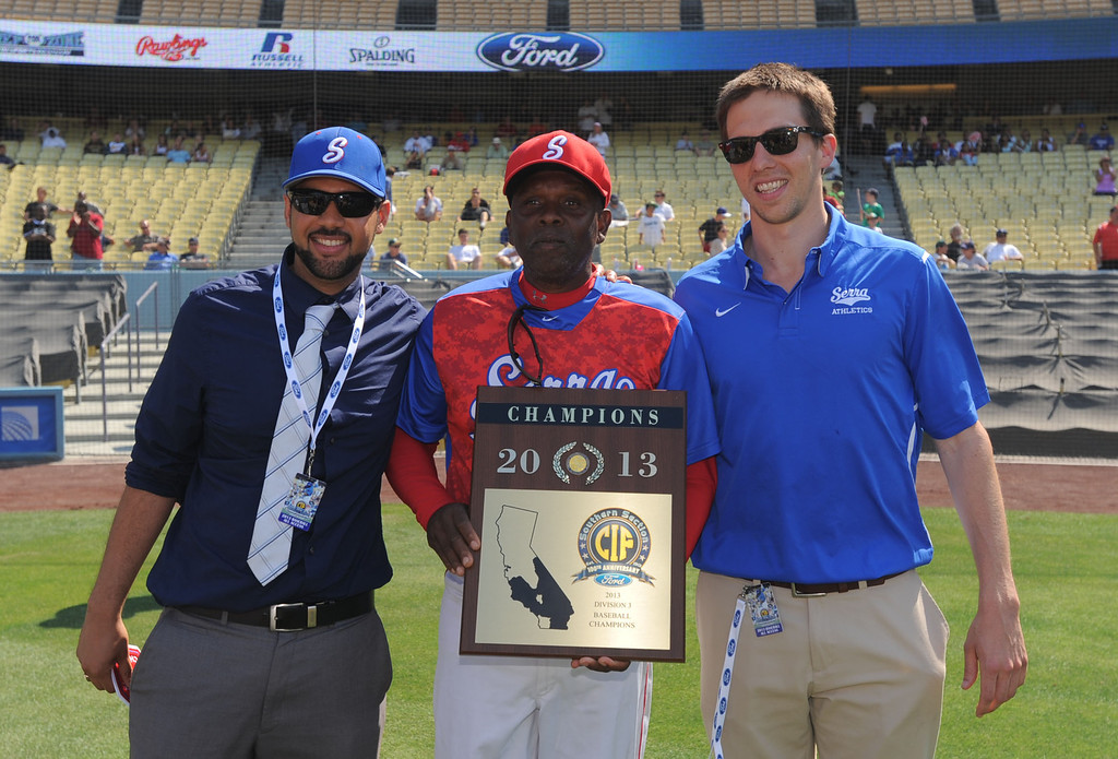 . Serra principal Christian De Larkin, left, coach Wil Aaron, center, and athletic director Ted Dunlap, right, hold their new championship plaque after beating Mira Costa in the CIF-SS Division III championship baseball game Friday at Dodger Stadium. Serra won the title, 8-1. 20130531 Photo by Steve McCrank / Staff Photographer