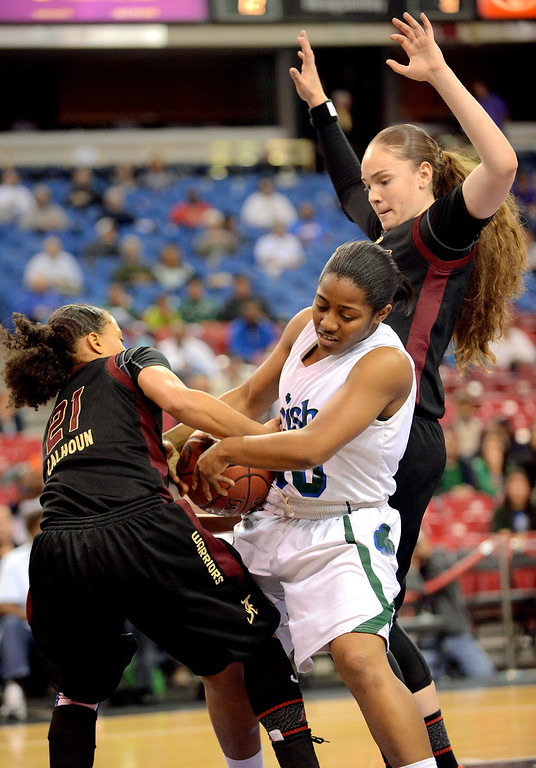 . Alemany\'s Hannah Johnson and Breanna Calhoun defend Kairee Howard of Sacred Heart Cathedral during the Div III 2013 CIF State Basketball Championship game at the Sleep Train Arena, in Sacramento, Ca March 22, 2013.  Alemany won the game 46-40.(Andy Holzman/Los Angeles Daily News)