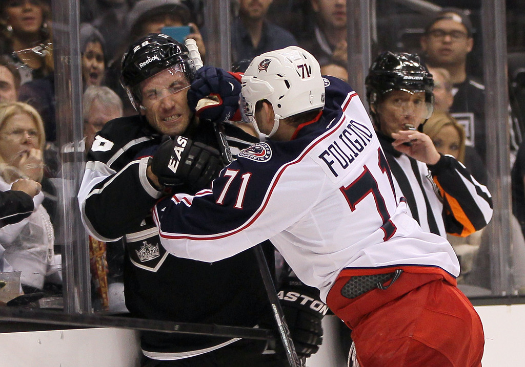 . LOS ANGELES, CA - APRIL 18:  Nick Foligno #71 of the Columbus Blue Jackets and Jarret Stoll #28 of the Los Angeles Kings exchange shoves after the end of the play in the second period during the NHL game at Staples Center on April 18, 2013 in Los Angeles, California. Stoll and Foligno received matching minors for roughing. (Photo by Victor Decolongon/Getty Images)