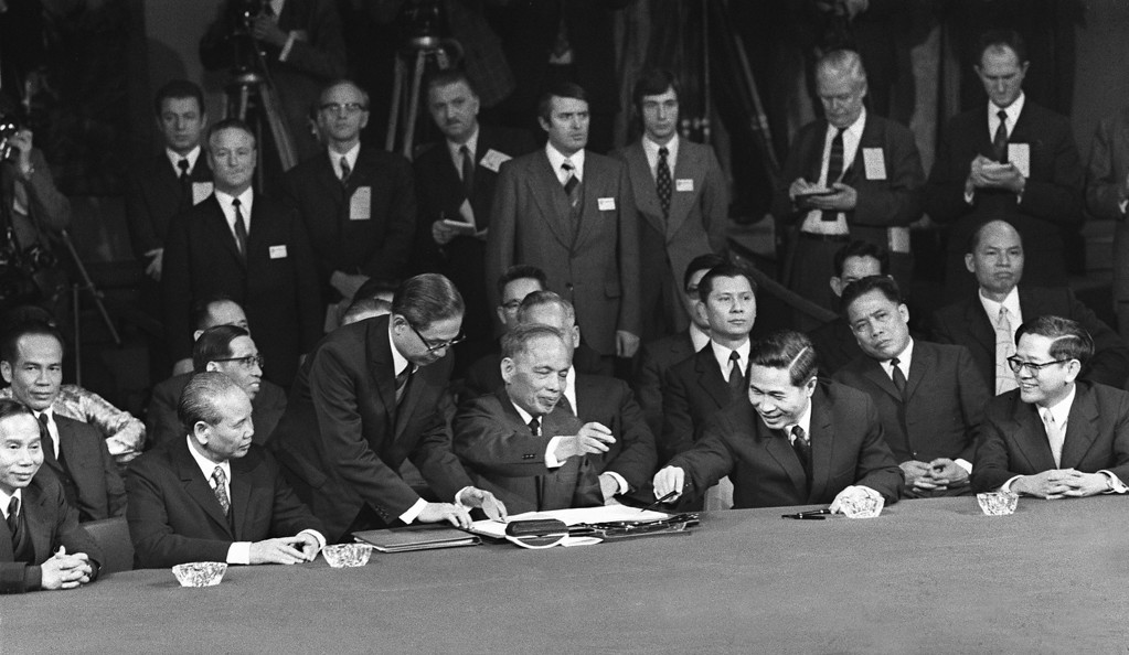 ". PARIS, FRANCE:  Photo taken 27 January 1973 in Paris, of US, South Vietnamese, North Vietnamese, and Viet Cong representatives signing the long-sought cease-fire agreement that ended the war in Viet-Nam. According to the 1st article of the peace agreement, the ""United States and all other countries respect the independence, sovereignty, unity, and territorial integrity of Viet-Nam as recognized by the 1954 Geneva Agreements on Viet-Nam\"". Was present North Vietman\'s Nguyen Duy Trinh (4thL). AFP PHOTO (Photo credit should read AFP/Getty Images)"