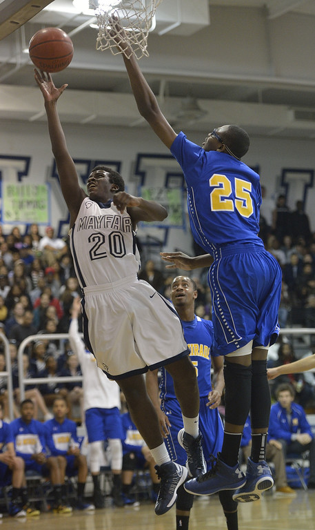 . LAKEWOOD, CALIF. USA -- Mayfair\'s Brandon Reynolds (20) goes up for a shot against La Mirada\'s Dezmon Murphy (25) in Lakewood, Calif., on February 8, 2013. Mayfair defeated La Mirada 60 to 59. Photo by Jeff Gritchen / Los Angeles Newspaper Group