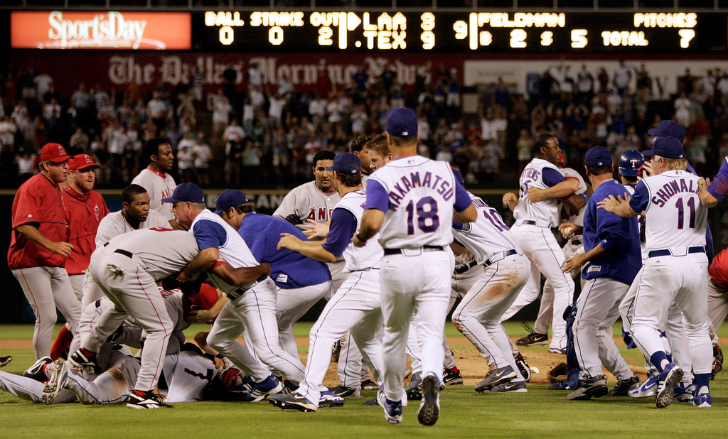 . Members of the Los Angeles Angels and the Texas Rangers clash in a brawl on the field after the Angels\' Adam Kennedy was hit by a Scott Feldman pitch in the ninth inning of a baseball game in Arlington, Texas. Wednesday, Aug. 16, 2006. The Rangers won 9-3.  (AP Photo/Tony Gutierrez)