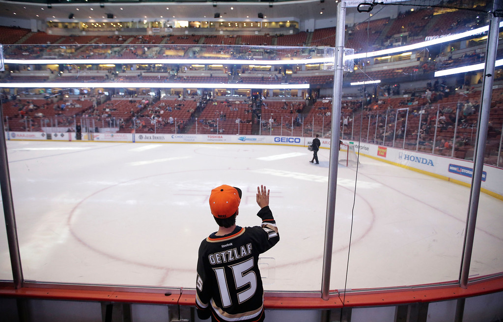 . A hockey fan looks on before an NHL hockey game between the Anaheim Ducks and the Colorado Avalanche in Anaheim, Calif., Wednesday, April 10, 2013. (AP Photo/Jae C. Hong)