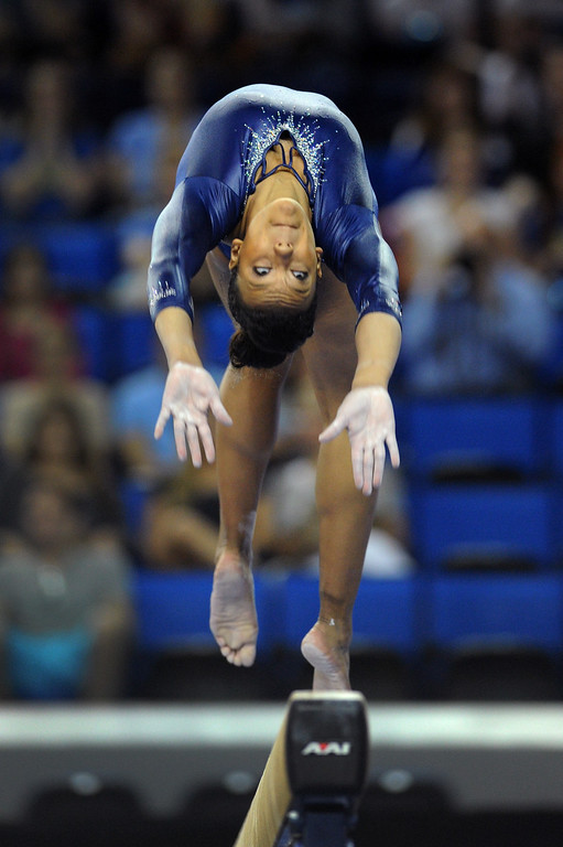 . UCLA\'s Lichelle Wong performs on the balance beam at the NCAA Women\'s Gymnastics Championship Team Finals at Pauley Pavilion, Saturday, April 20, 2013. (Michael Owen Baker/Staff Photographer)