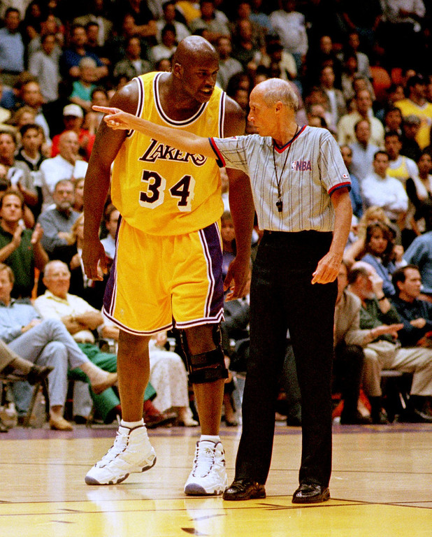 . Los Angeles Lakers\' Shaquille O\'Neal (34) is told to leave the court by referee Dick Bavetta after being thrown out of the game during the second half against the Utah Jazz Thursday, May 8, 1997, in Inglewood, Calif.  The Lakers beat the Jazz 104-84 in Game 3 of their Western Conference semifinal playoff series. (AP Photo/Chris Pizzello)