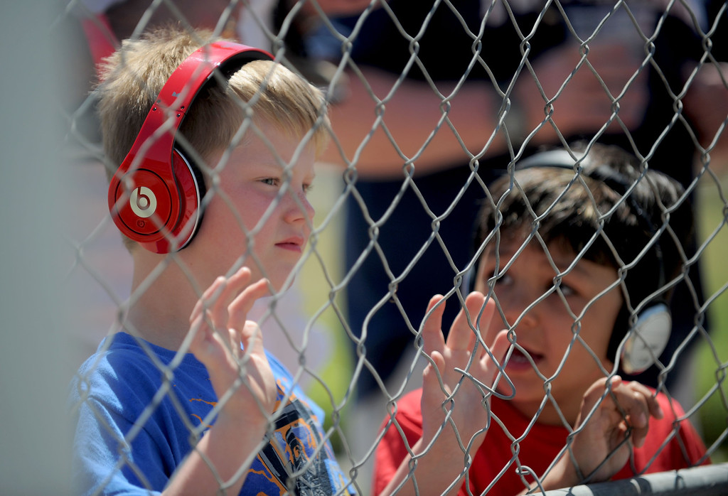 . 04-20-2013-(LANG Staff Photo by Sean Hiller)- Cooper Christian,7, left, and Andreas Nicolaidis, 5, watch turn 1 at the Toyota Grand Prix of Long Beach Saturday.