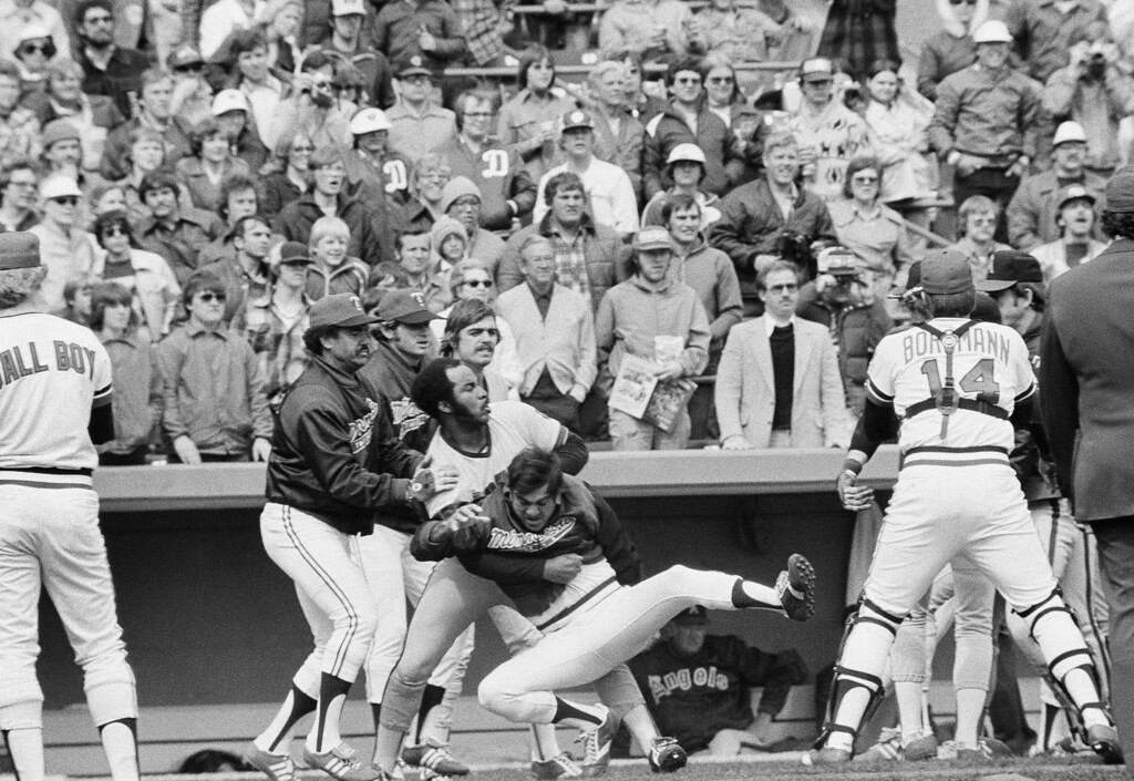 . An unidentified Minnesota Twins player is pulled down by California Angels Ron Jackson as Jackson and Twins Jose Morales, left, and Geoff Zahn watch the rest of the action in a bench clearing brawl, April 22, 1978 in Bloomington which was precipitated when Angels Bobby Grich charged Twins pitcher Roger Erickson on a pitch he didn\'t like. (AP Photo/Jim Mone)