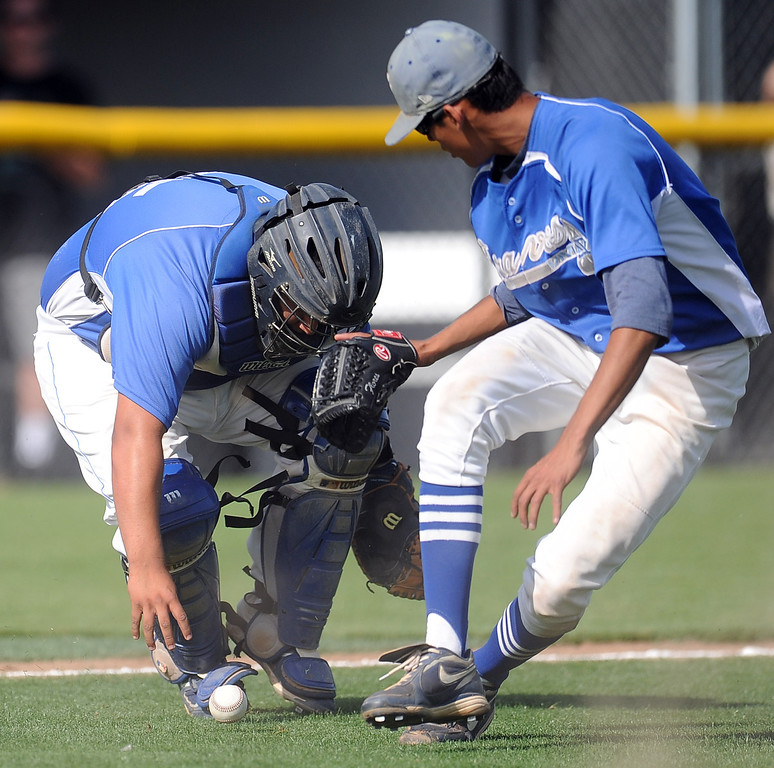 Description of . Northview's Anthony Amaya (not pictured) singles as Baldwin Park starting pitcher Bernardo Flores (C) and catcher Daniel Escobedo reaches for the baseball in the fourth inning of a prep baseball game against Northview at Northview High School on Tuesday, April 23, 2012 in Covina, Calif. Northview won 8-2.    (Keith Birmingham/Pasadena Star-News)