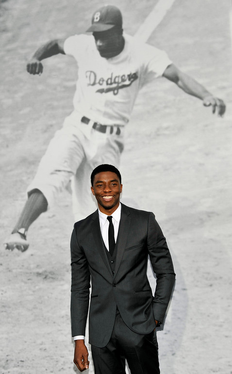 "Description of . Chadwick Boseman, who plays baseball legend Jackie Robinson in ""42,\"" poses at the Los Angeles premiere of the film at the TCL Chinese Theater on Tuesday, April 9, 2013 in Los Angeles. (Photo by Chris Pizzello/Invision/AP)"