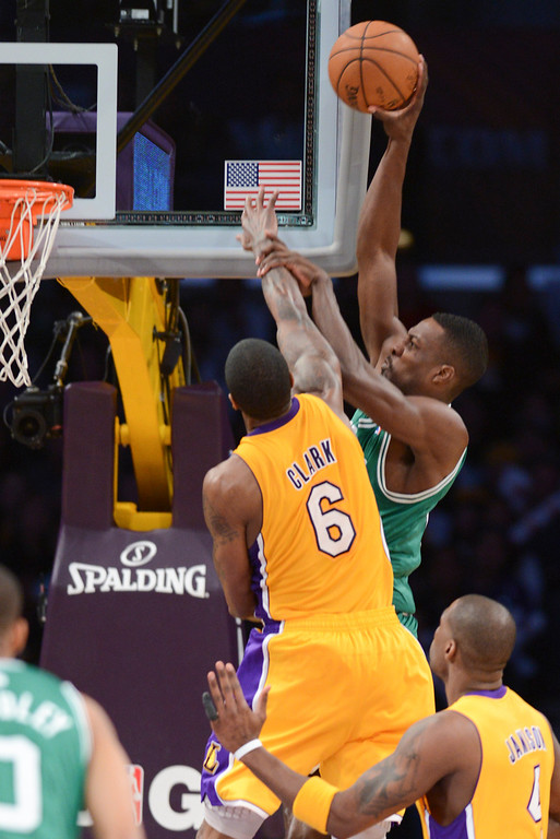 . Celtics\' Jeff Green keeps Lakers\' Earl Clark at bay as he shoots for two points during second half action at Staples Wednesday. Lakers defeated the Celtics 113-99.  Photo by David Crane/Staff Photographer
