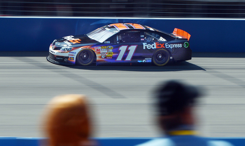 . BS23-NASACARFONTANA-077-WL (Will Lester/Staff Photographer) NASCAR driver Denny Hamlin races across the front straightaway during the morning practice session Friday. Hamlin later won the pole position for Sunday\'s Auto Club 400 Friday March 22, 2013. Hamlin lapped the 2-mile super speedway in 38.410 seconds at an average speed of 187.451mph.