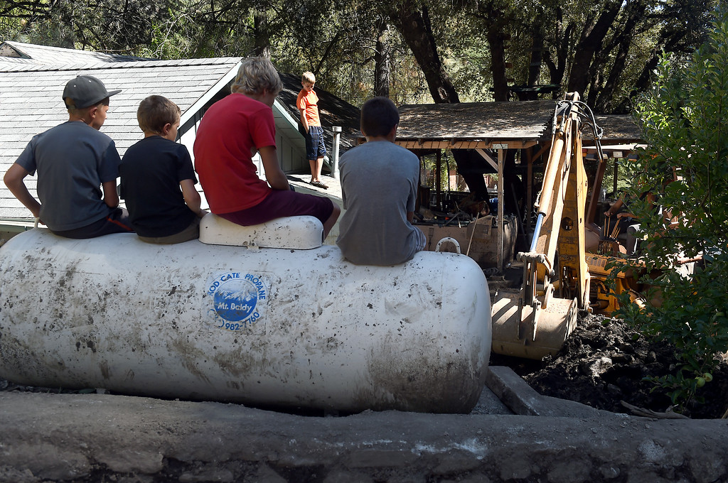 Description of . Kids take a break from the clean-up from Sunday's storm in Mt. Baldy, CA, Tuesday, August 5, 2014. (Photo by Jennifer Cappuccio Maher/Inland Valley Daily Bulletin)