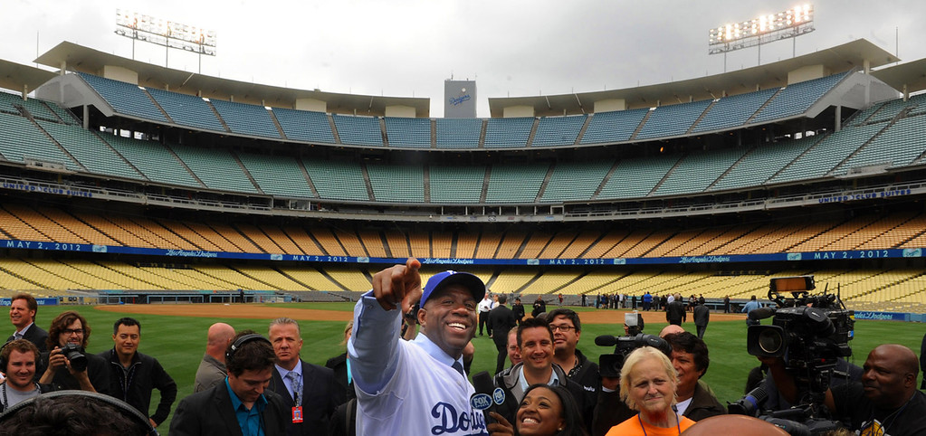 . Los Angeles Dodgers part-owner, Ervin �Magic� Johnson smiles for the television camera after a press conference announcing the new ownership of the Los Angeles Dodgers by the Guggenheim Baseball Management Group in Los Angeles on Wednesday, May 2, 2012.  (Keith Birmingham/Pasadena Star-News)