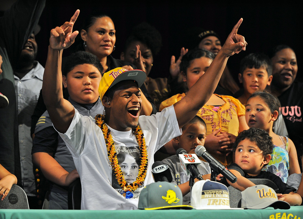 """. In front of a national television audience and surrounded by his large family, Long Beach Poly football player John \""""JuJu\"""" Smith announces that he will play football for USC during a ceremony at Poly in Long Beach, CA on Wednesday, February 5, 2014. The other schools he was considering were Oregon, Notre Dame and UCLA. (Photo by Scott Varley, Daily Breeze)"""